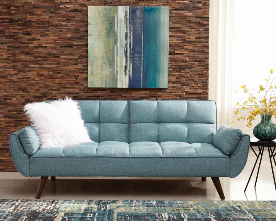 Caufield biscuit-tufted sofa bed turquoise blue